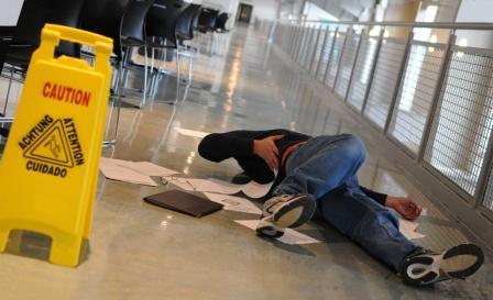 man with injured back after falling on slick floor