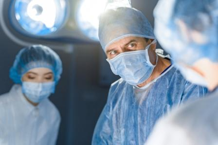 surgeon looking at staff member in operating room