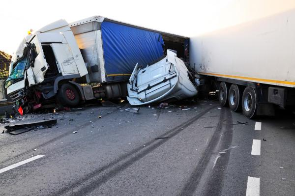 truck accident involving 2 trucks and another vehicle