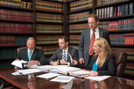 our attorneys reviewing workers comp case | Johnson & Biscone, P.A.