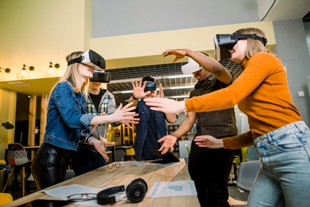 young professionals experiencing virtual reality with headset devices