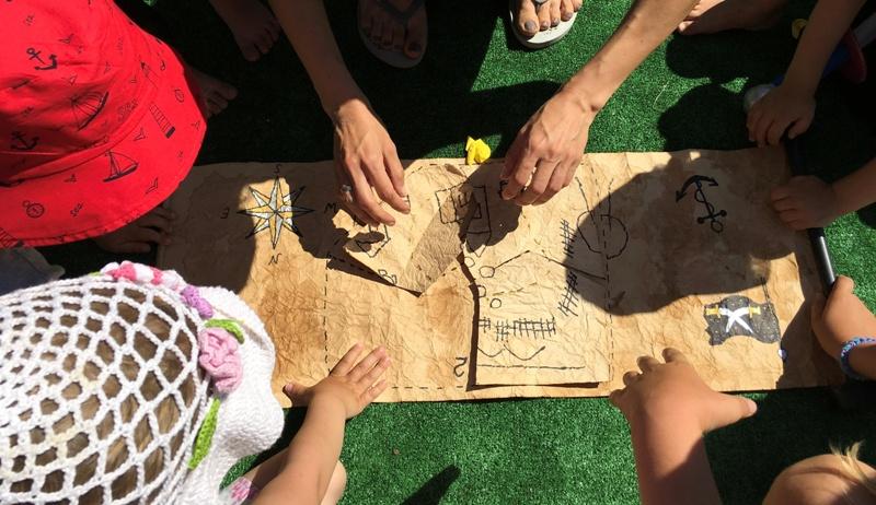 children looking at treasure map