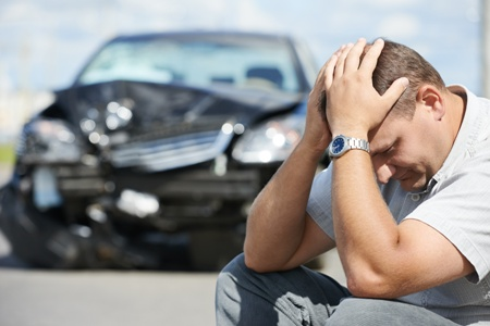 stock photo example for law firms - upset man at scene of car accident