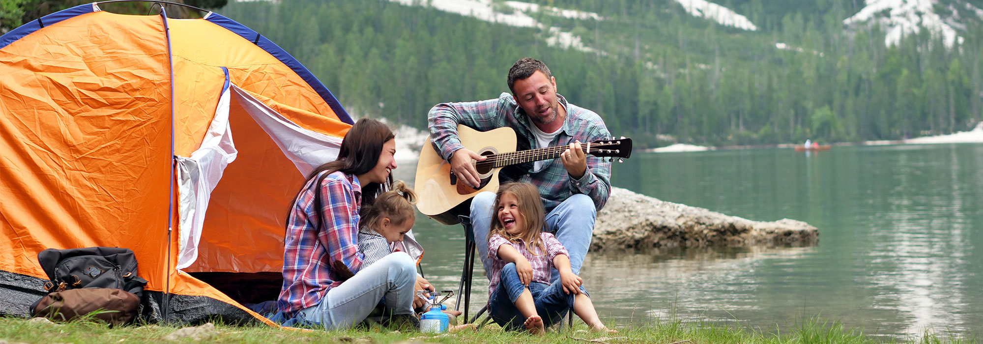 family camping and playing guitar