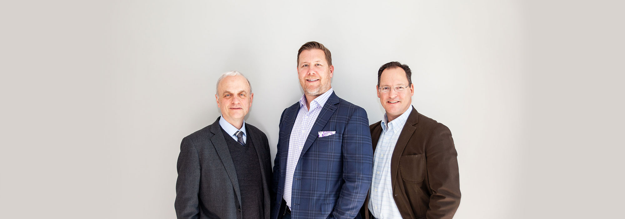 portrait of the surgeons at Park Meadows Cosmetic Surgery
