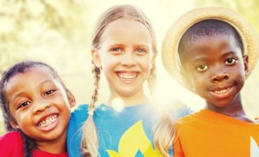 Young children smiling in the sunshine - Family Dentistry at Meadows Dental Group