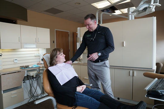 Dr. Scott Peppler with Patient - Meadows Dental Group - Lone Tree, CO