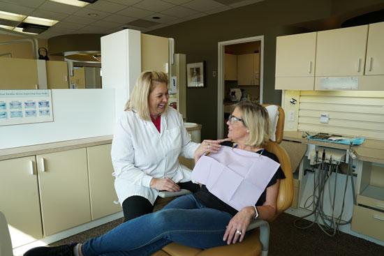 Hygienist with Patient 3 - Meadows Dental Group - Lone Tree, CO
