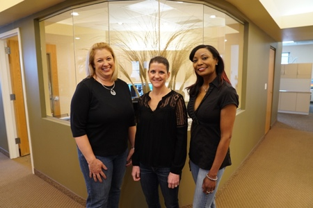dental hygienists standing at the front desk of Meadows Dental Group