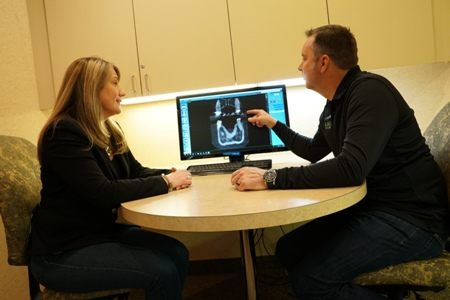 general dentist Dr. Scott Peppler reviewing a dental X-ray