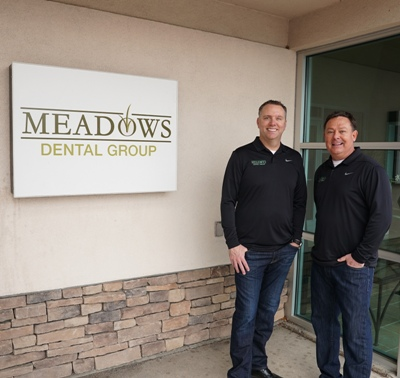 Dr. Peppler and Dr. O'Leary standing outside the front entrance of Meadows Dental Group