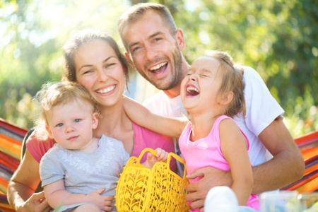 joyful smiling family outside