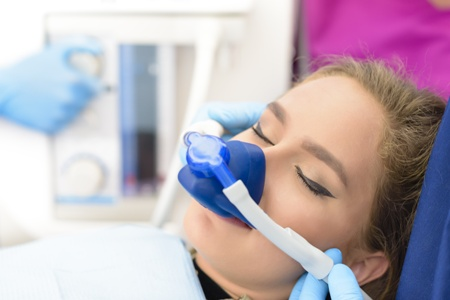 woman getting dental sedation with nitrous oxide