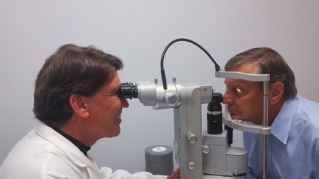 Dr. Stonecipher performing eye exam on cataract patient in Greensboro, North Carolina