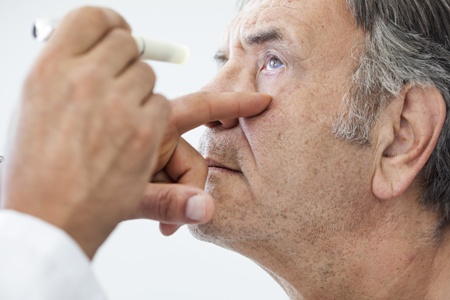 doctor examining male cataract patient