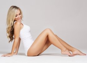 Blond woman in white underwear sitting down.