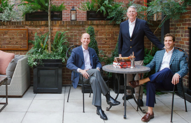Portrait of the doctors at Plastic Surgeons of Lexington at a rooftop restaurant.
