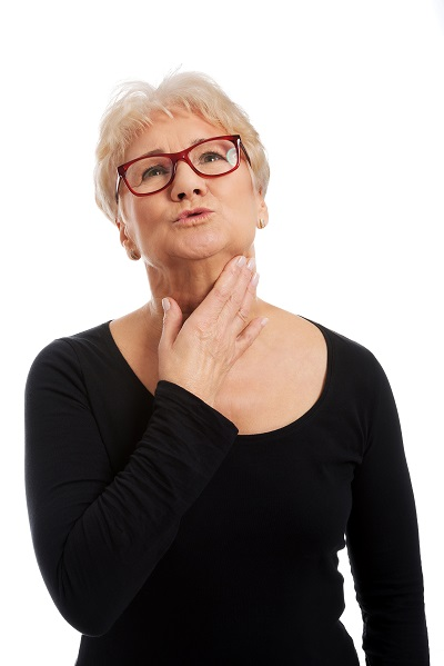 woman holding the jowls in her neck region