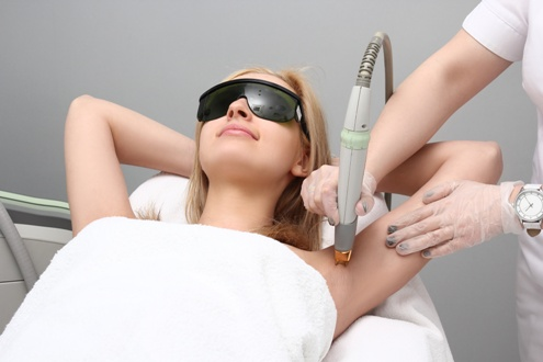 laser hair removal treatment on the underarm of a young woman