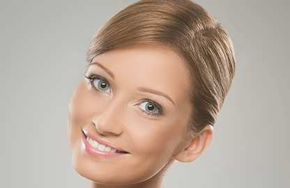 Blonde Woman with Youthful Appearance in Her Face & Neck - Facial Plastic Surgery by Dr. Scott Greenberg