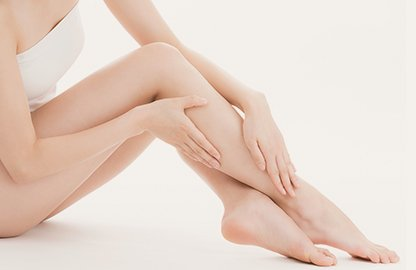 Woman with Clear Skin on Her Arms & Legs - Lakemont Laser Center Skin Treatments
