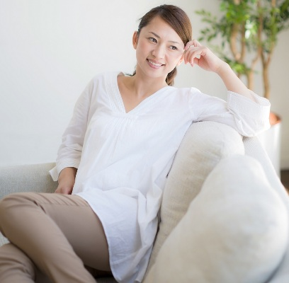 smiling woman relaxing on couch