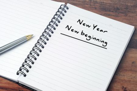 notebook with message in pen reading 'New Year, New Beginnings'