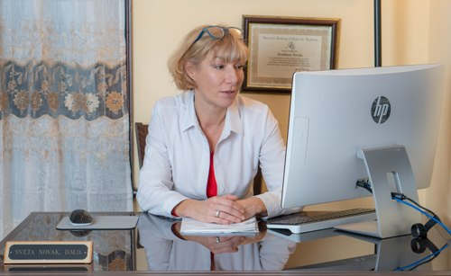 Sveta Novak, DMD, at her desk at South Natick Dental