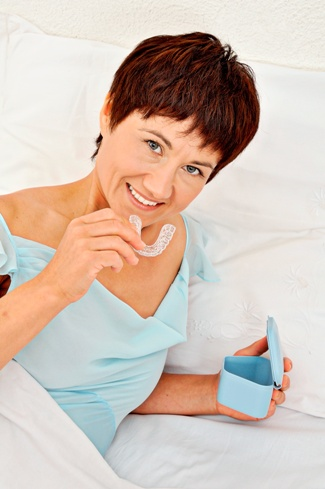 woman in bed with sleep apnea snore guard