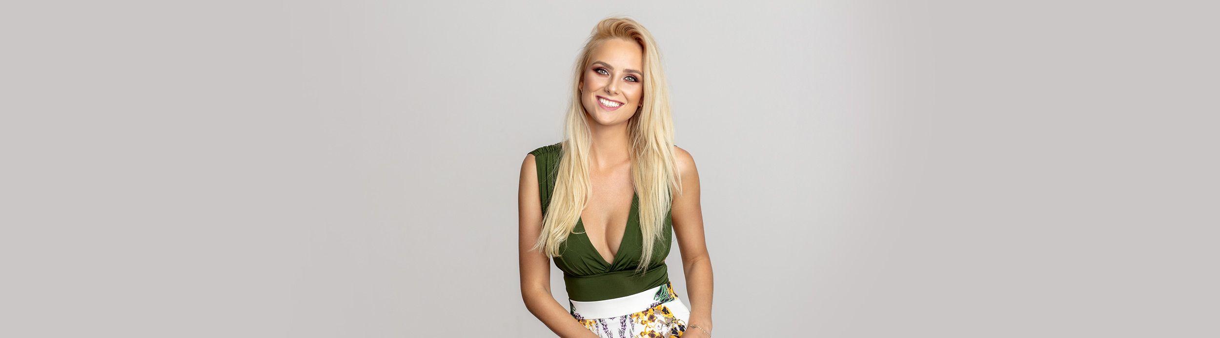 Blonde woman a green top