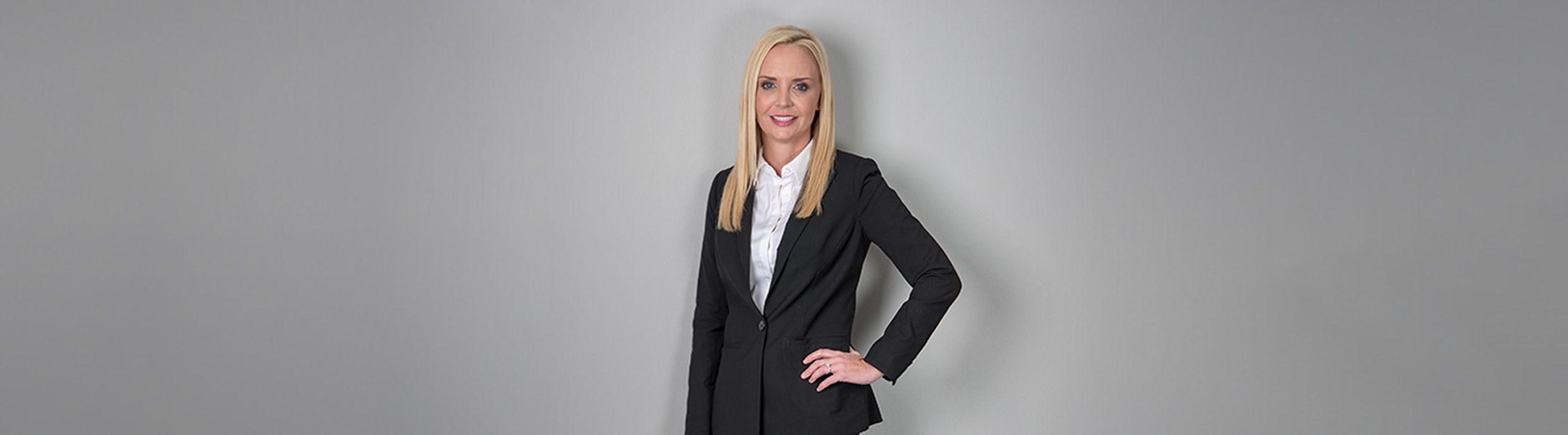 Portrait of Dr. Brenda Schiesel in a suit