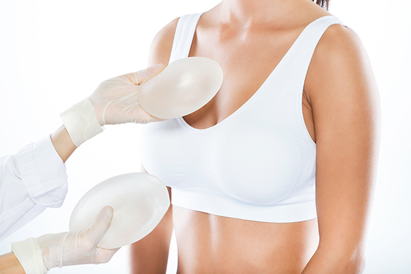 Female plastic surgeon, Dr. Brenda Schiesel, provides breast implant options to patient