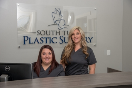 two staff members at the South Tulsa Plastic Surgery front desk