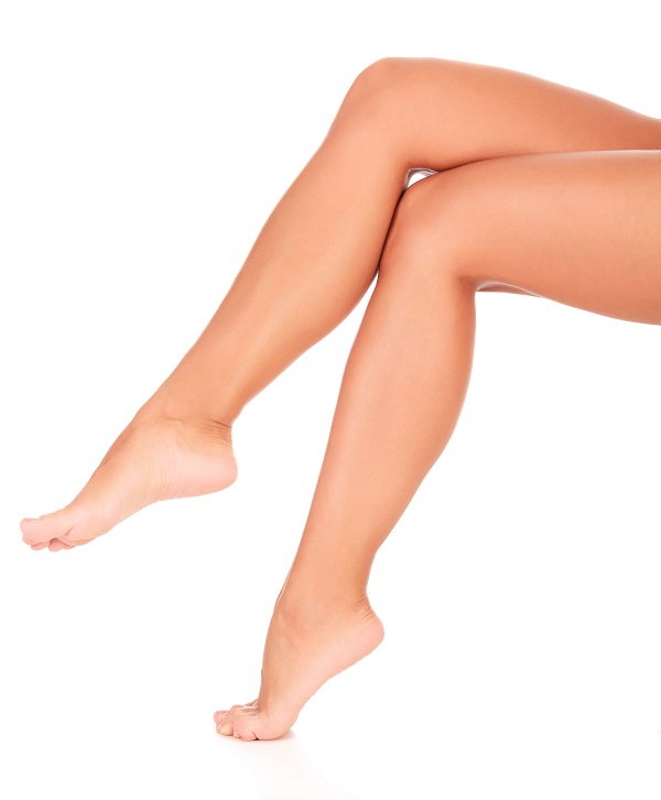 Woman's smooth legs crossed after sclerotherapy