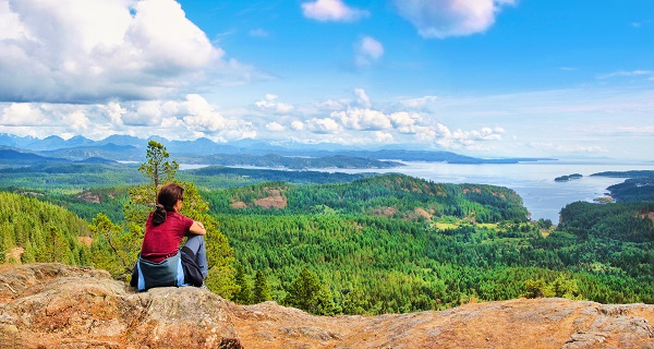 Hiker resting and taking in the view on Vancouver Island