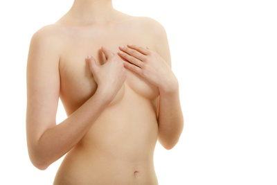 nude woman hides breasts with hands