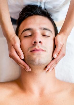 man getting a facial massage