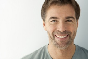 Man smiling with a dental implant in Omaha
