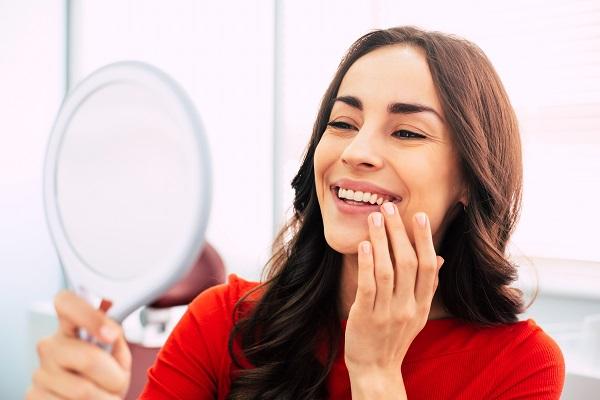 Woman-viewing-teeth-in-mirror.jpg