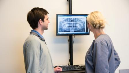 Dr. Snow and Dr. Ruf reviewing a dental X-ray | The Dentists at Ralston Square