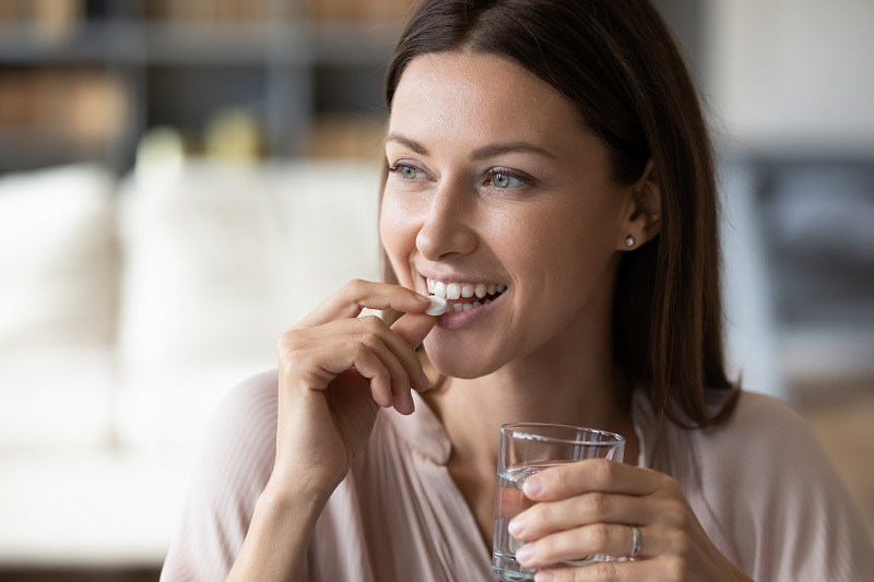 Woman taking an oral sedative before her dentist appointment