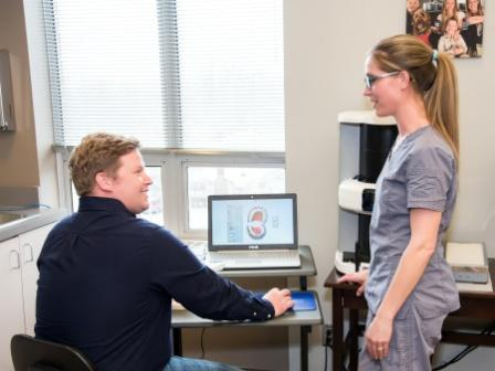 Dr. Demman reviewing dental implant scan with staff member | The Dentists at Dundee
