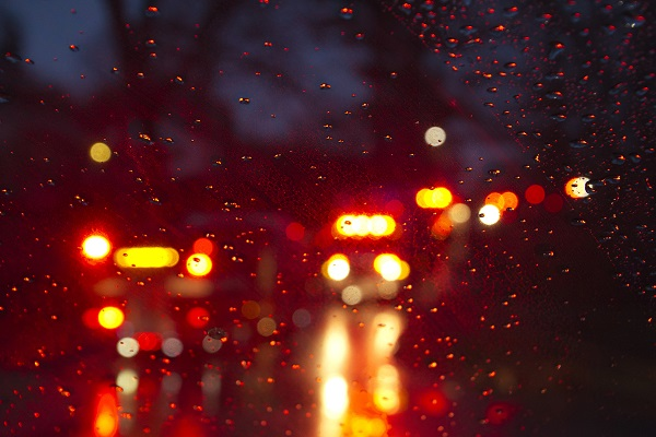 Emergency-vehicles-through-rainy-glass.jpg
