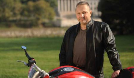Mark Troy Attorney with his motorcycle