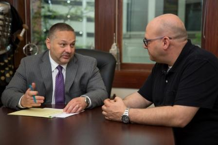 Injury Lawyer Mark Troy meeting with client