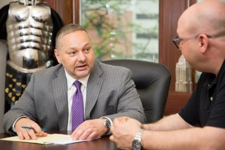 Personal injury attorney Mark Troy in consultation with client