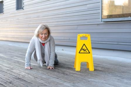 senior woman on hands and knees after slip and fall