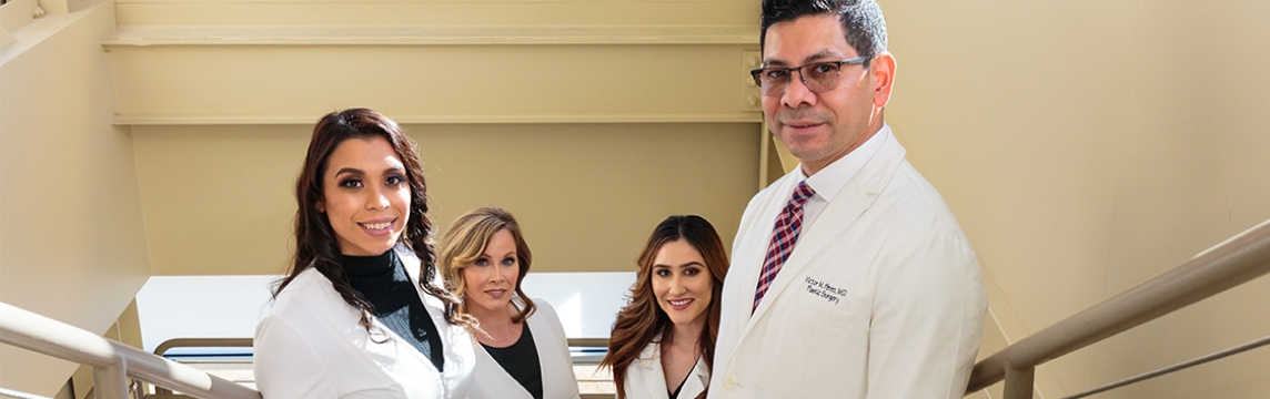 Portrait of office staff with Doctor Victor Perez