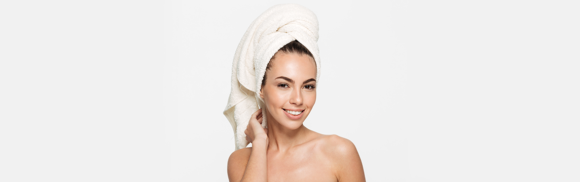 Woman with amazing skin wearing her towel over her hair.