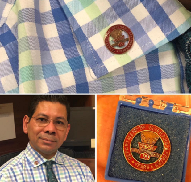 Commemorative pin recognizing Dr. Victor Perez's 15 years of service at the Kansas City VA